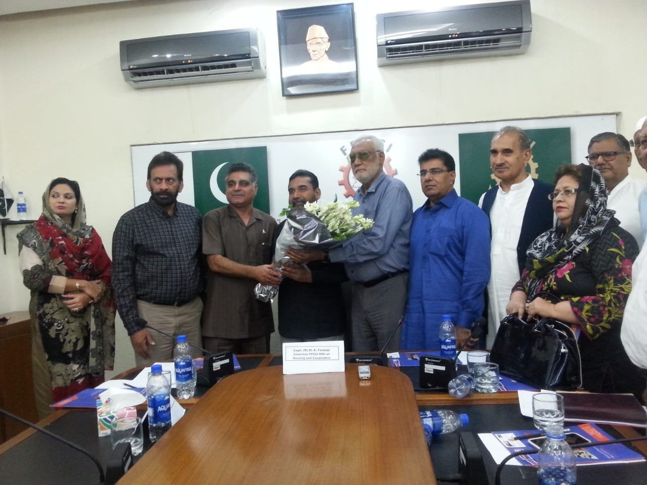 President NFC-ECHS receiving bouquet at meeting of Pakistan Federation of Commerce and Industries (Cooperative Housing Sector)